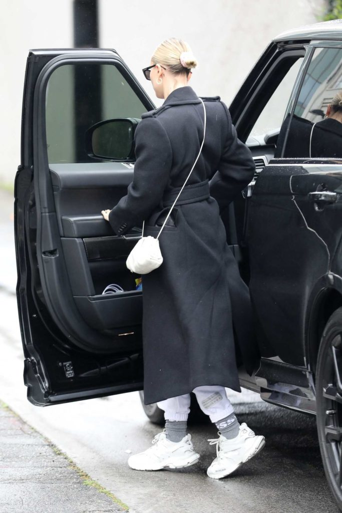 Hailey Bieber in a Black Coat