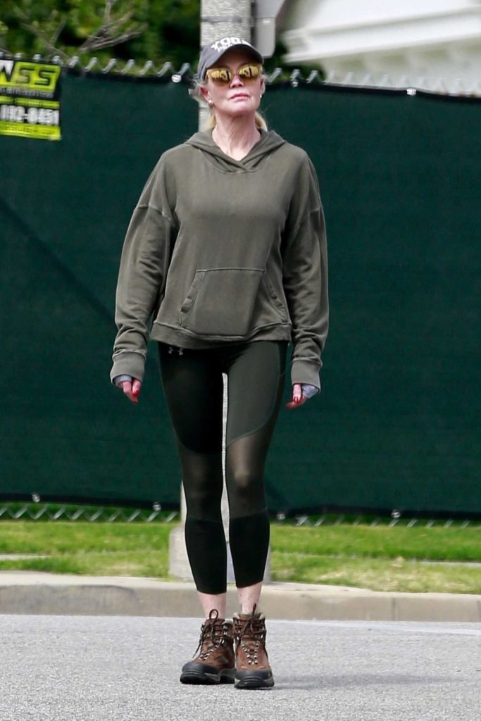 Melanie Griffith in a Black Cap