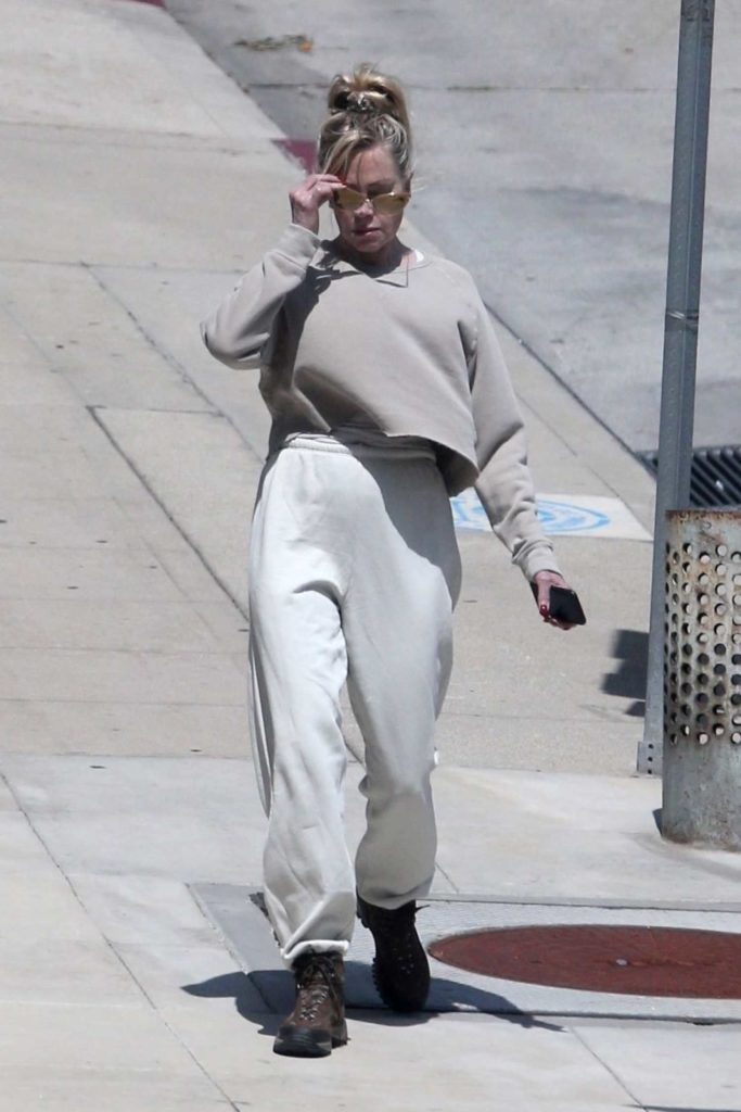 Melanie Griffith in a White Sweatpants