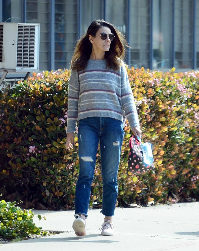 Mila Kunis in a Blue Ripped Jeans