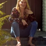 Molly Sims in a Black Floral Blouse Chats with a friend on Her Doorstep in Pacific Palisades