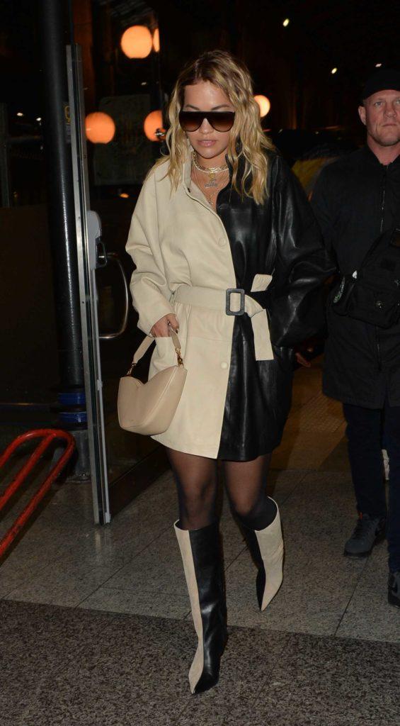 Rita Ora in a Black and Beige Coat