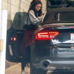 Sarah Hyland in a White Sneakers Arrives at a Friends House in Los Angeles
