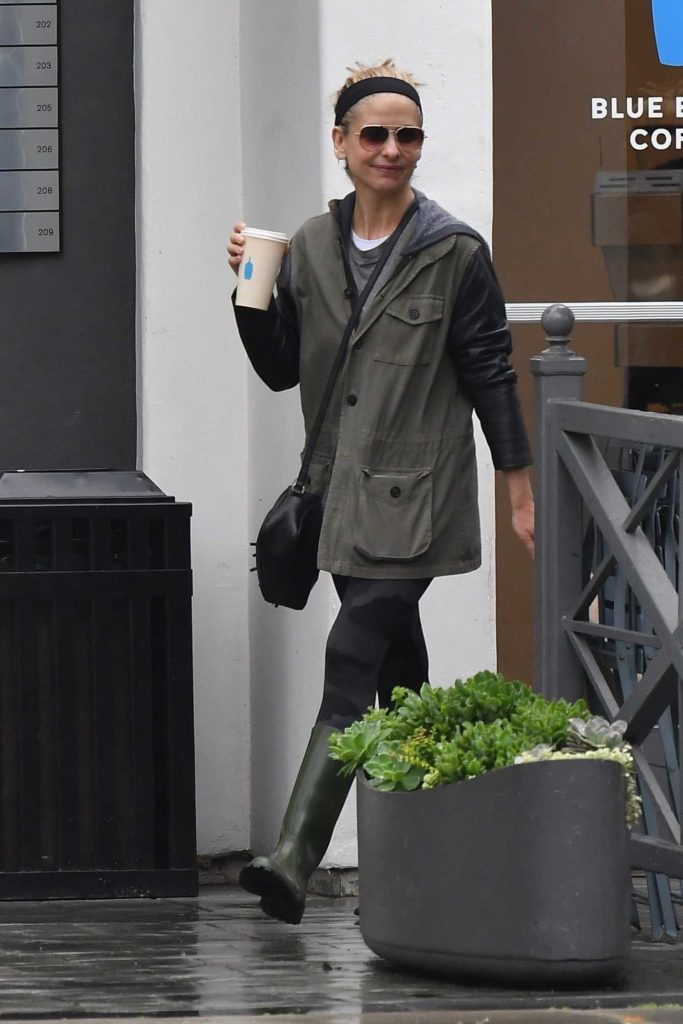 Sarah Michelle Gellar in a Green Rubber Boots