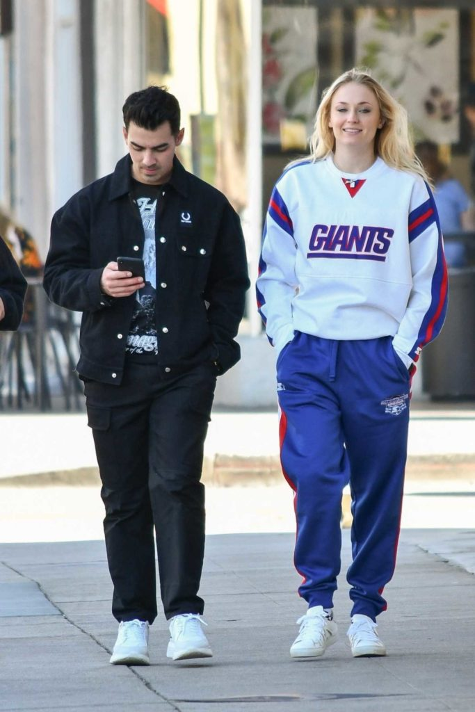 Sophie Turner in a White Sneakers