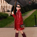 Zoey Deutch in a Red Trench Coat Arrives at the Valentino Fashion Show in Paris