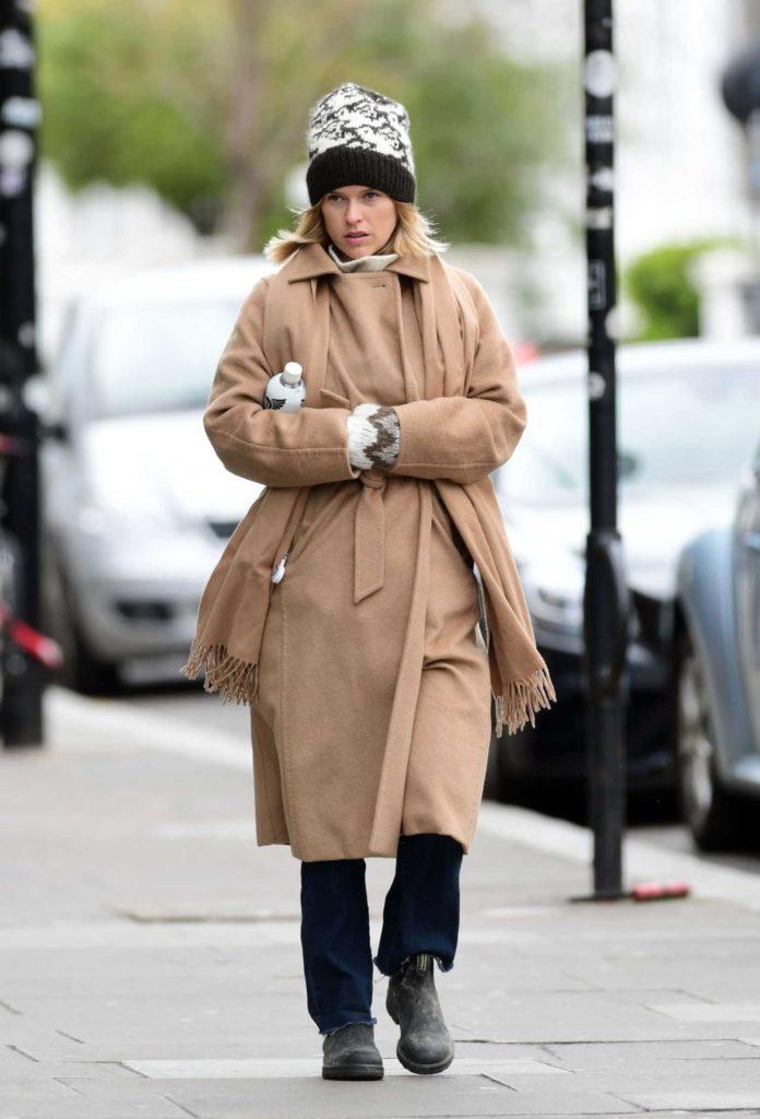 Alice Eve in a Beige Coat