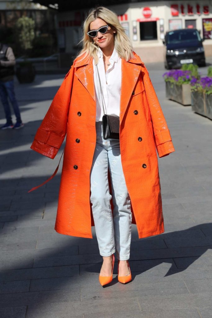 Ashley Roberts in an Orange Leather Trench Coat