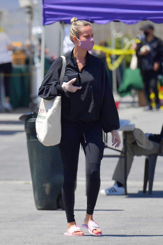 Brie Larson in a Purple Face Mask