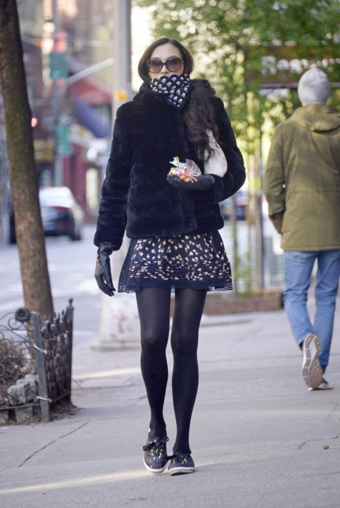 Famke Janssen in a Short Black Fur Coat