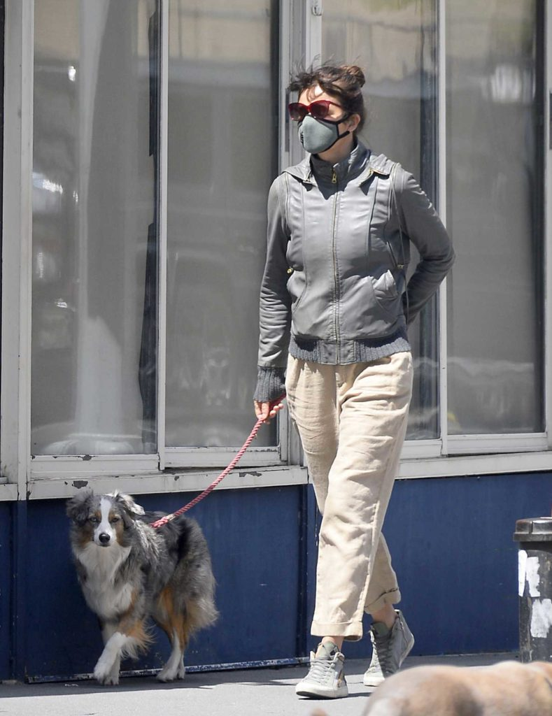 Helena Christensen in a Beige Pants