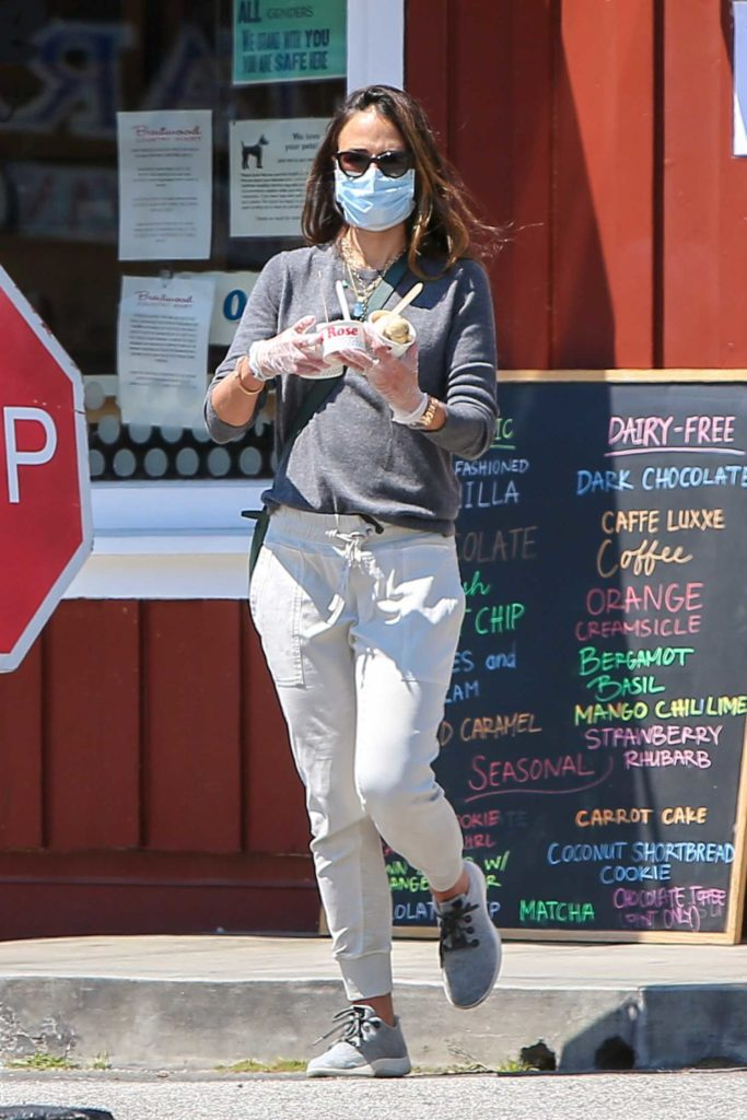 Jordana Brewster in a Blue Face Mask