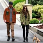 Lily Collins in a Black Boots Walks Her Dog Out with Charlie McDowell in Beverly Hills