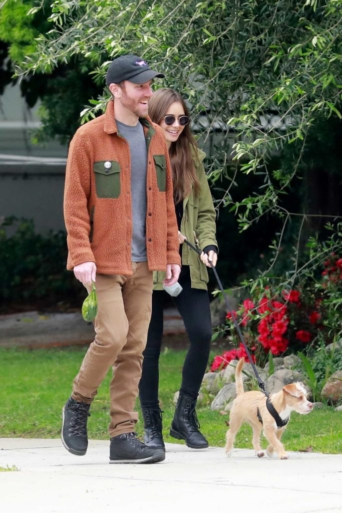 Lily Collins in a Black Boots