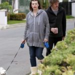 Milla Jovovich in a Gray Hoody Walks Her Dogs Out with Paul Anderson in Beverly Hills