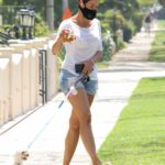 Nicole Murphy in a Ripped Shorts Walks Her Dog in Beverly Hills