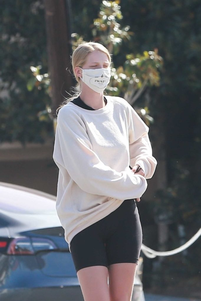 Abby Champion in a Face Mask