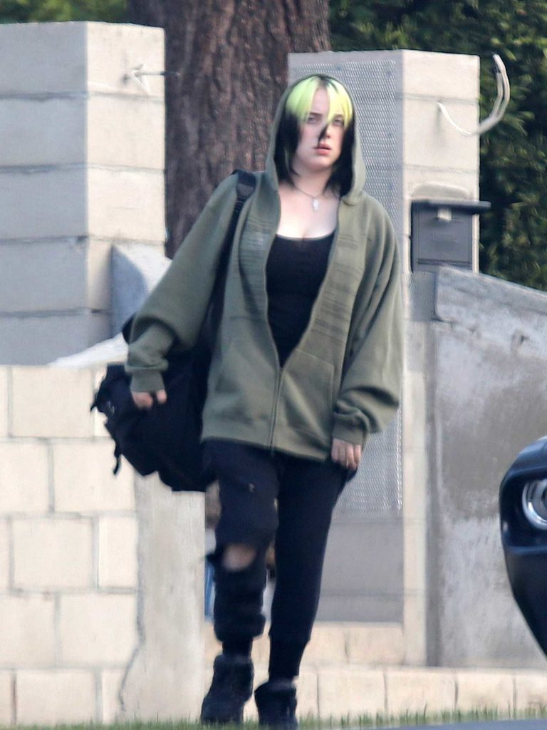 Billie Eilish in a Black Ripped Jeans