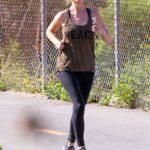 Christina Anstead in a Tan Tank Top Enjoys a Jog in Newport Beach