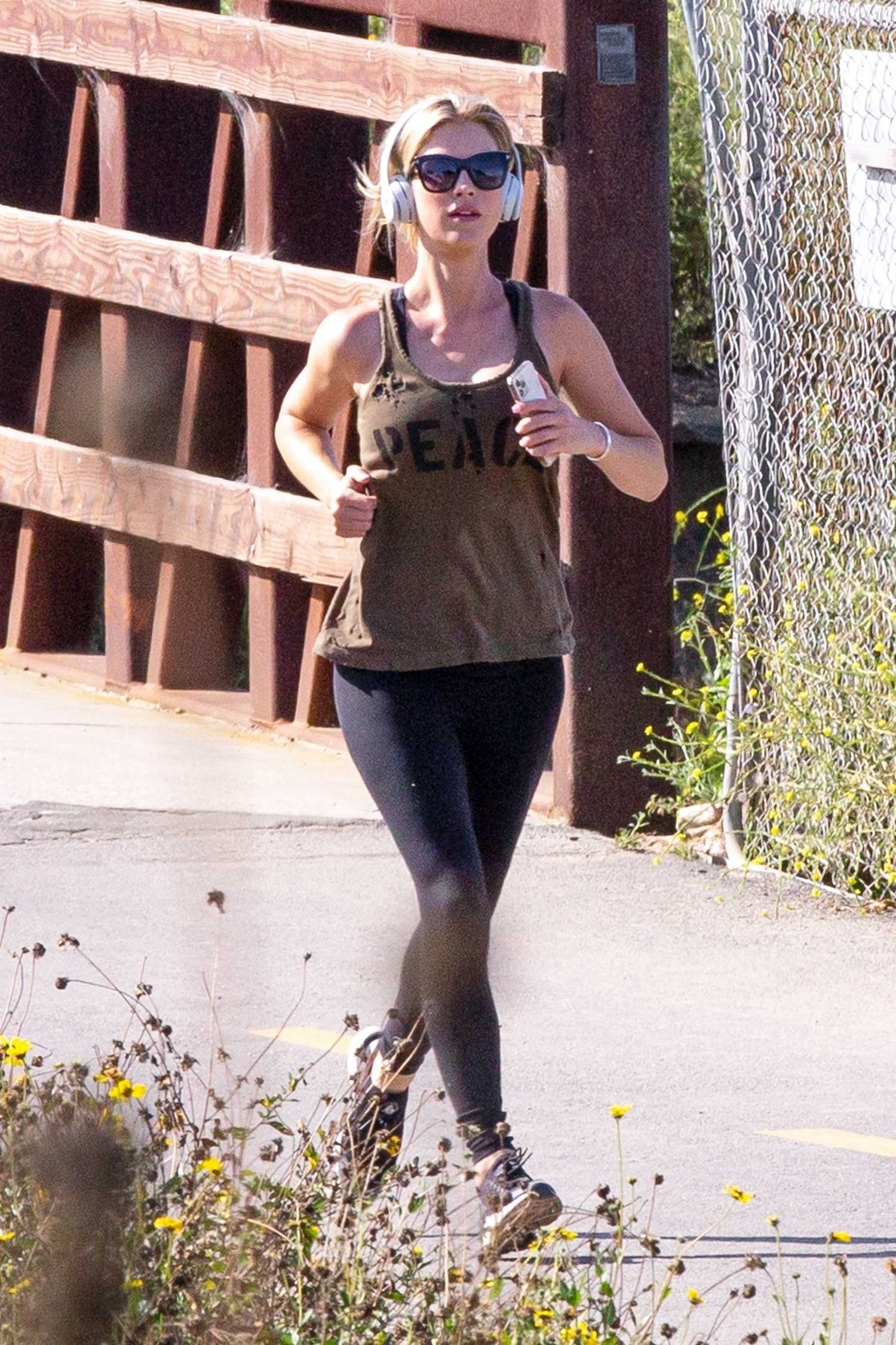 Charli XCX in a Yellow Long Sleeves T-Shirt Leaves a Gym