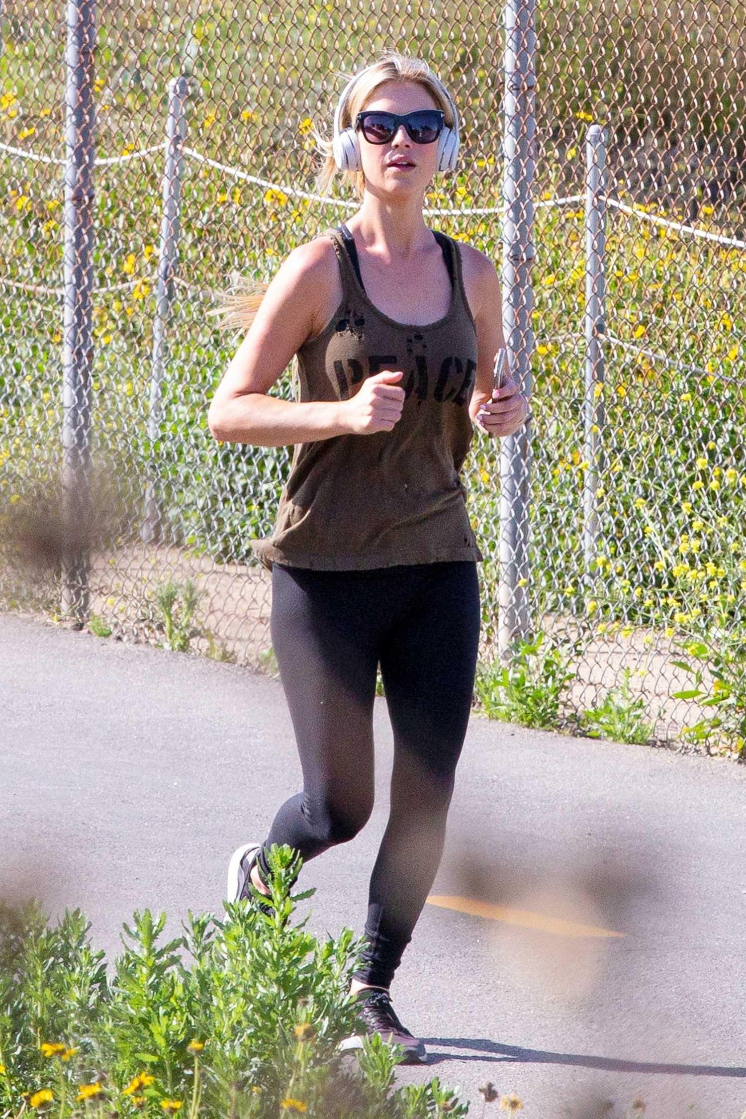 Christina Anstead in a Tan Tank Top Enjoys a Jog in