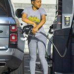 Christina Milian in a Gray Tee Pumps Some Gas in Studio City