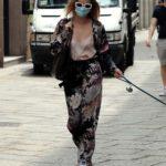 Elena Barolo in a White Sneakers Walks Her Little Dog in Milan