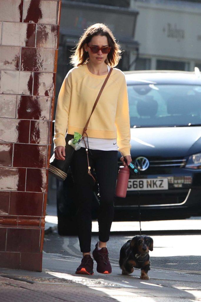 Emilia Clarke in a Yellow Sweatshirt