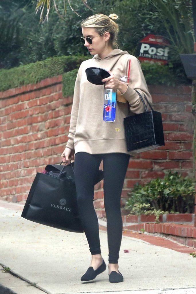 Emma Roberts in a Beige Hoody
