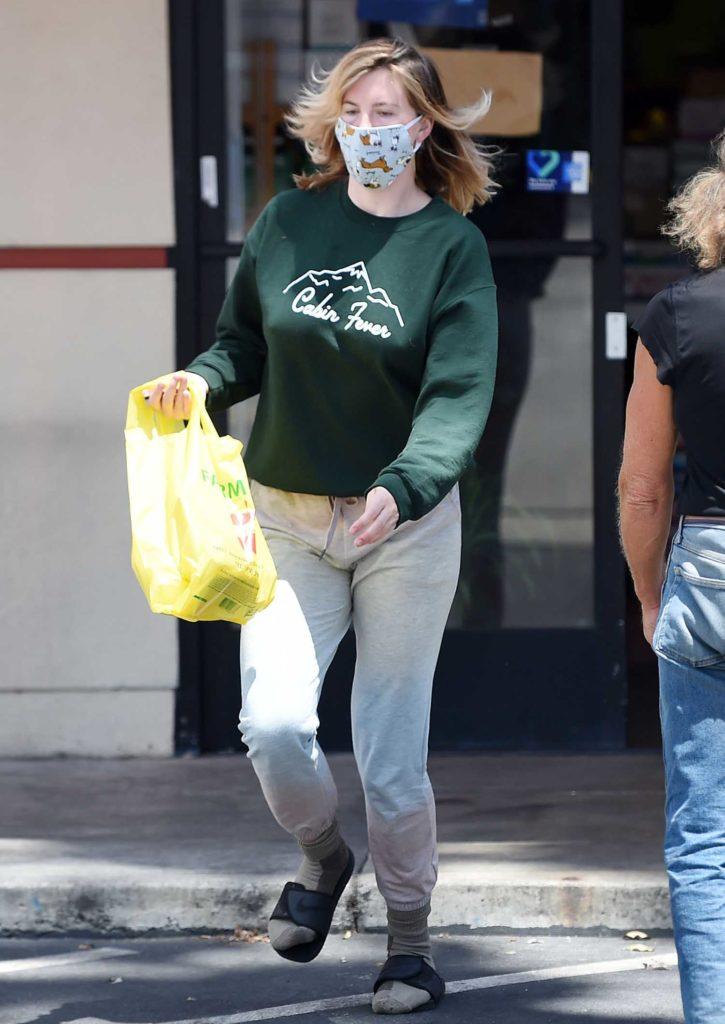 Ireland Baldwin in a Green Sweatshirt
