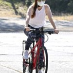 Isla Fisher in a White Sneakers Does a Bike Ride in Los Angeles