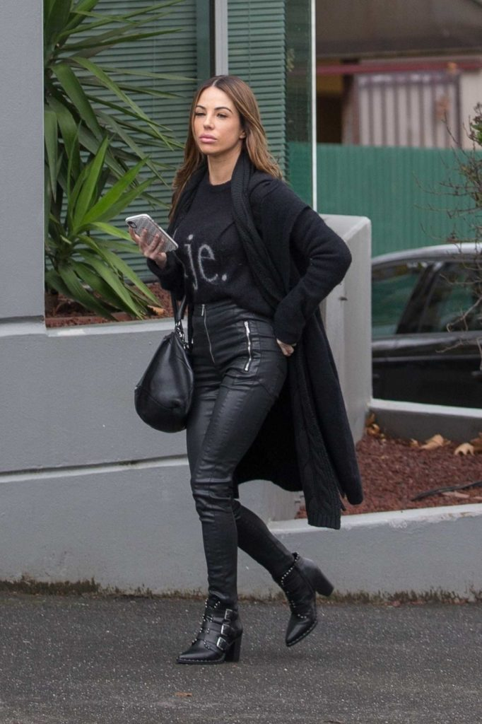 Kasey Osborne in a Black Cardigan