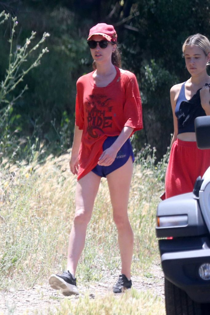 Margaret Qualley in a Red Cap