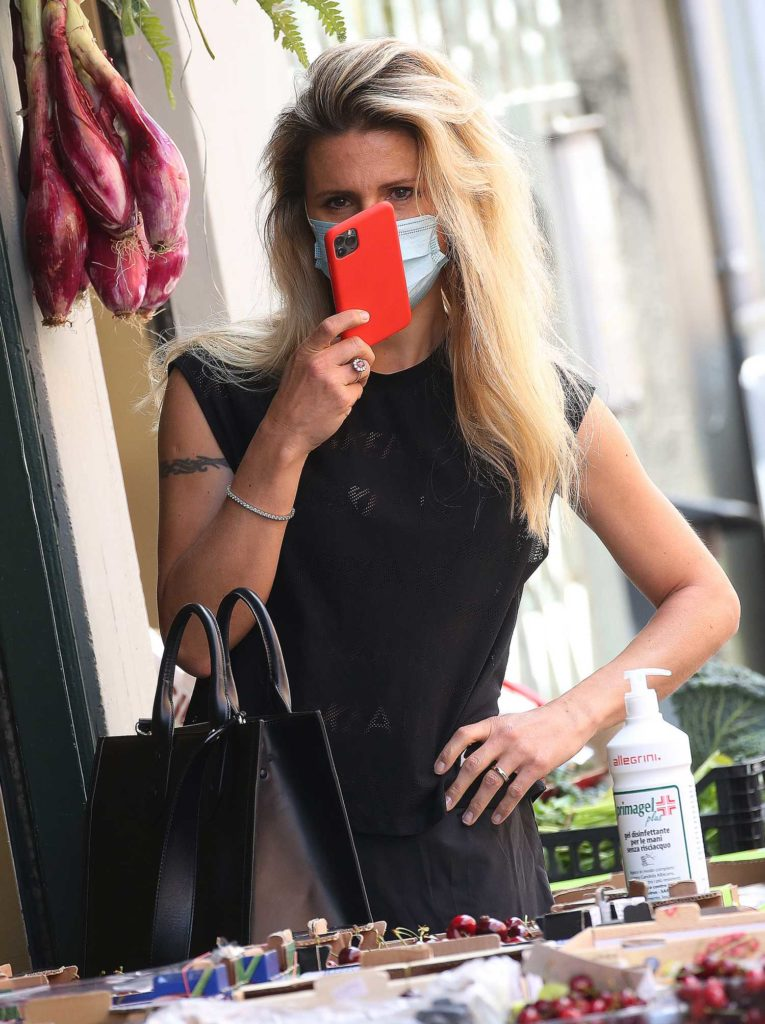 Michelle Hunziker in a Protective Mask