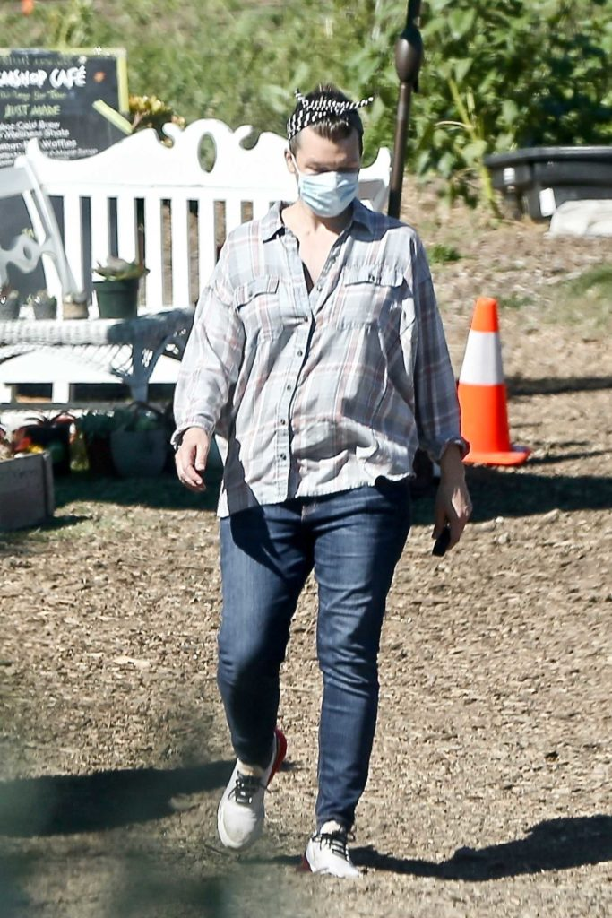 Milla Jovovich in a Protective Mask