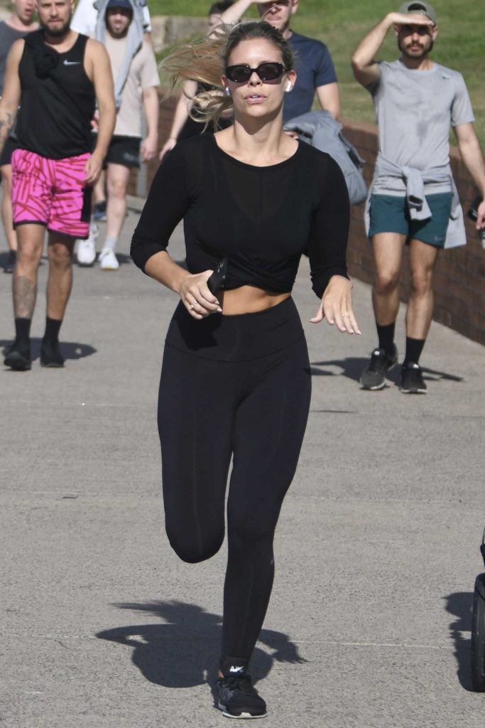 Natasha Oakley in a Black Leggings