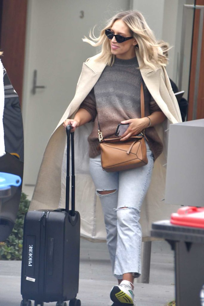 Phoebe Burgess in a Beige Trench Coat