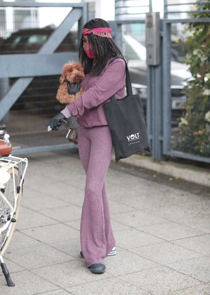 Sinitta in a Purple Jogging Suit