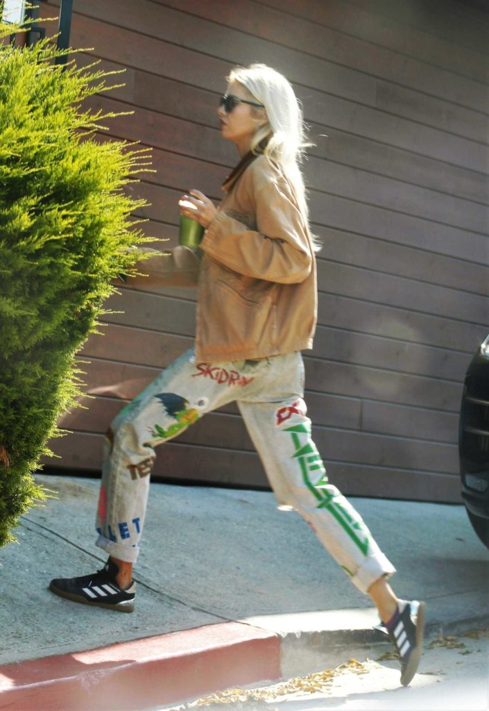 Stella Maxwell in a Beige Jacket