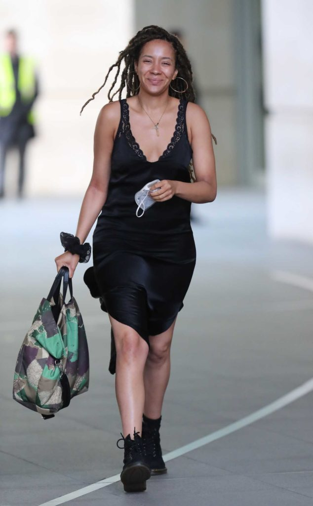 Yasmin Evans in a Black Silk Dress