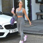 Yazmin Oukhellou in a Gray Workout Clothes Collects a Takeaway Lunch from Restaurant in London