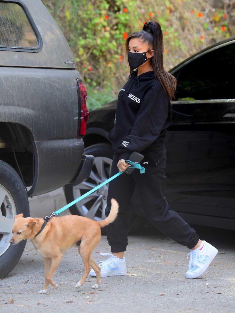 Ariana Grande in a Black Protective Mask