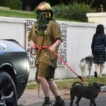 Billie Eilish in a Green Bandana as a Face Mask Walks Her Dog in Los Angeles