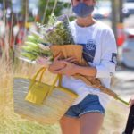 Brie Larson in a Daisy Duke Shorts Shops for Flowers at a Farmer's Market in Malibu