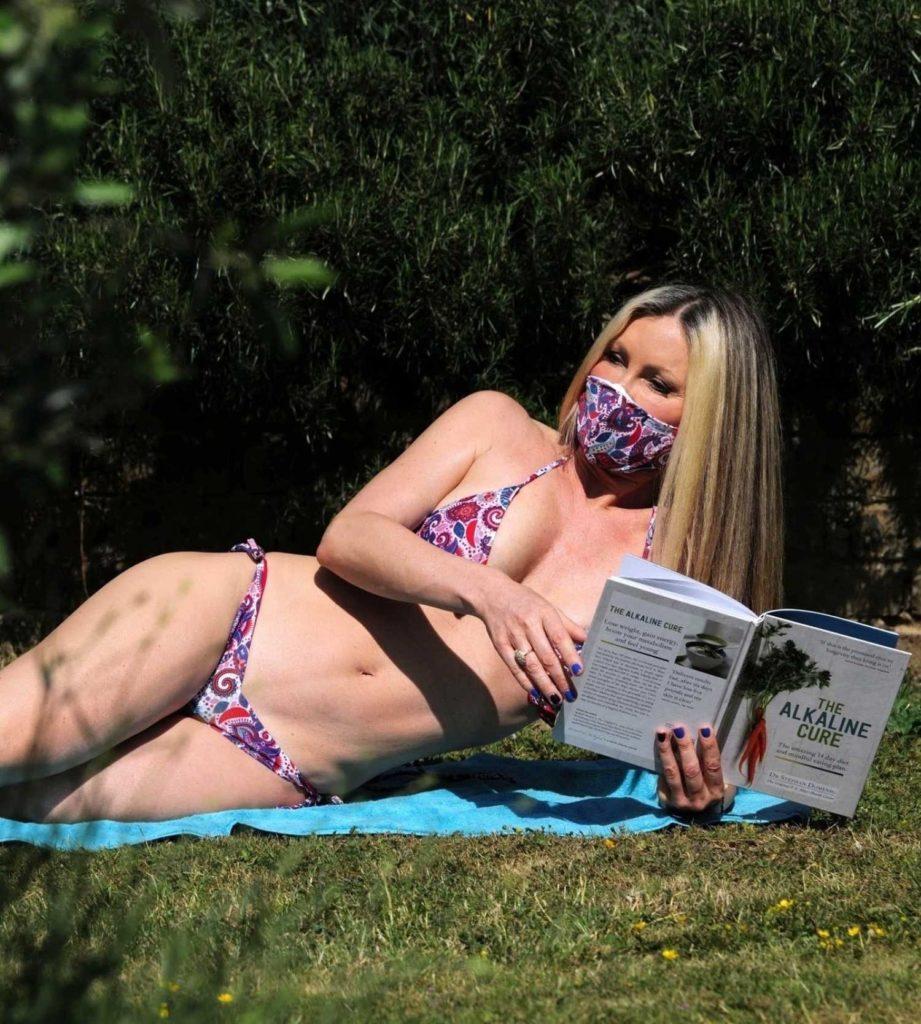 Caprice Bourret in a Floral Print Bikini