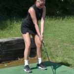 Chloe Ross in a Black Top Plays Golf at Romford Golf Club in Essex