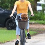 Devon Windsor in a Yellow Tee Enjoys a Bike Ride with Her Dog in Miami