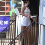 Helena Christensen in a White Shorts Leaves a FedEx Store in the West Village