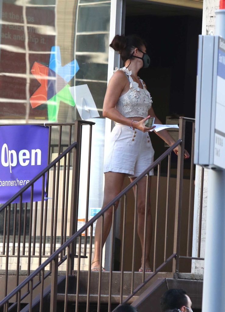 Helena Christensen in a White Shorts