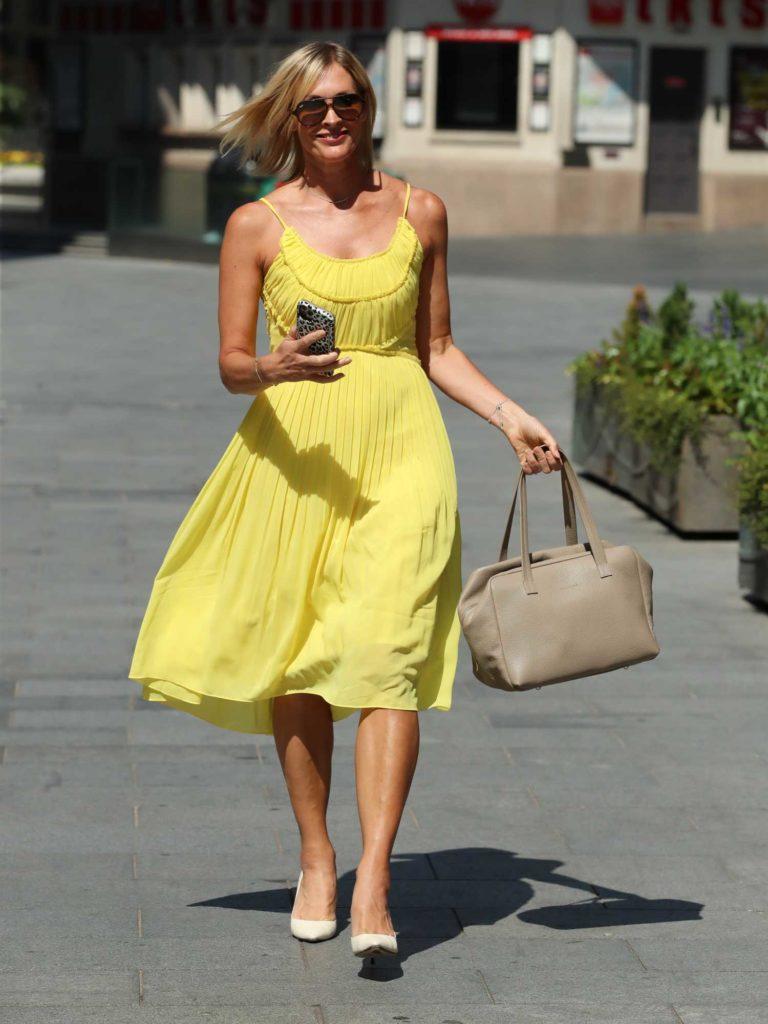 Jenni Falconer in a Yellow Dress